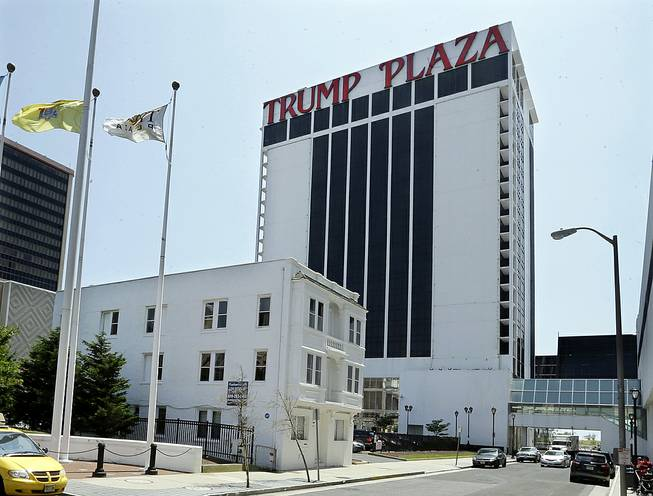 The Trump Plaza towers over Vera Coking's three-story rooming house Wednesday, July 23, 2014, in Atlantic City. The decrepit boarding home owned by the Atlantic City woman who has been turning down multimillion-dollar offers for the building in the shadow of Trump Plaza since the 1980s has been demolished.