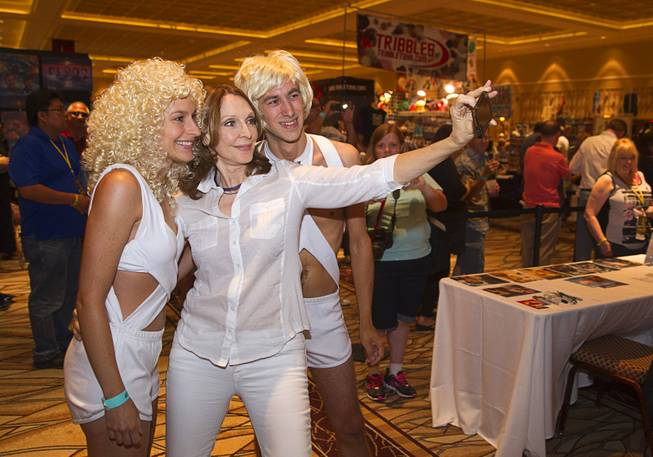 "Actress Denise Crosby, center, takes a selfie with Lisa Kovacevic and Brandon Nigl during the 13th annual Official Star Trek Convention at the Rio Thursday, July 31, 2014. Crosby played Lt. Tasha Yar in ""Justice,"" a Star Trek: The Next Generation episode that took place on Rubicun III. Kovacevic and Nigl are dressed as Edo, the inhabitants of the planet."