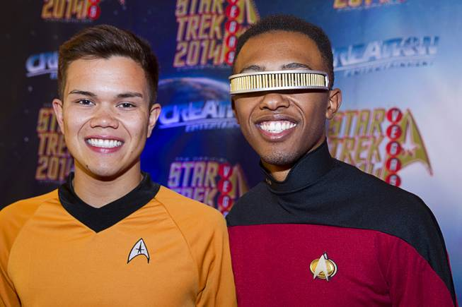 Michael Arnold, left, of Wrightwood, Calif., (as Mr. Sulu) and Desmond Franklin of Victorville, Calif. (as Lt. Commander Geordi La Forge) pose during the 13th annual Official Star Trek Convention at the Rio Thursday, July 31, 2014. The convention, expected to attract 15,000 Trekkies, runs through Sunday.