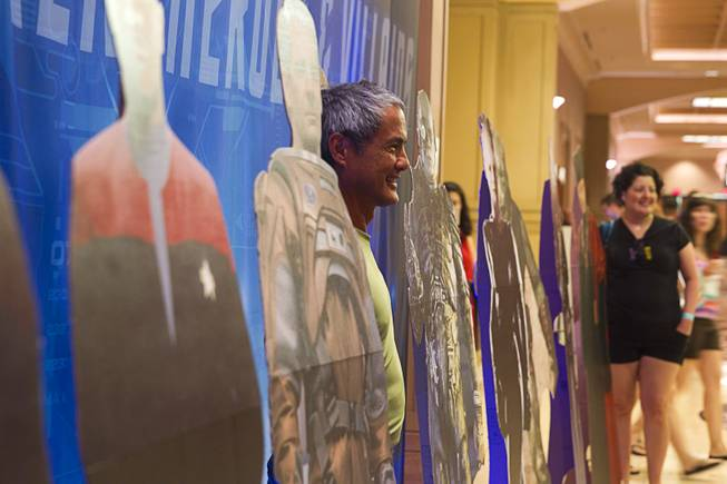 Nick Kishmirian of Sebastopol, Calif. poses among cardboard cutouts of Star Trek characters during the 13th annual Official Star Trek Convention at the Rio Thursday, July 31, 2014. The convention, expected to attract 15,000 Trekkies, runs through Sunday.