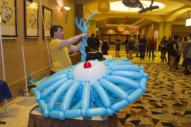 "Roger ""The Balloon Wizard"" Godin creates a model of the USS Enterprise out of balloons during the 13th annual Official Star Trek Convention at the Rio Thursday, July 31, 2014. The convention, expected to attract 15,000 Trekkies, runs through Sunday."