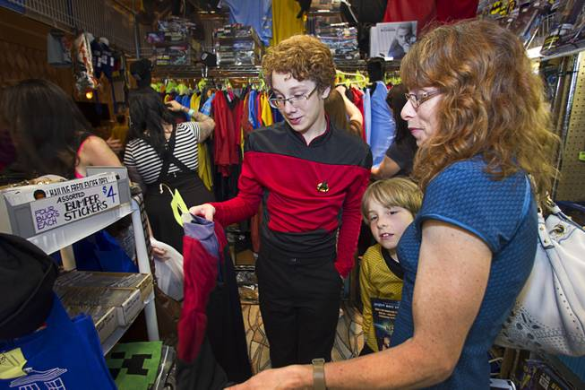 Cyrus Bickell, 13, of Evergreen, Colo. shops for uniforms with his brother Cole,9, and his mother Valerie during the 13th annual Official Star Trek Convention at the Rio Thursday, July 31, 2014. Bickell said he has watched every Star Trek episode in chronological order.