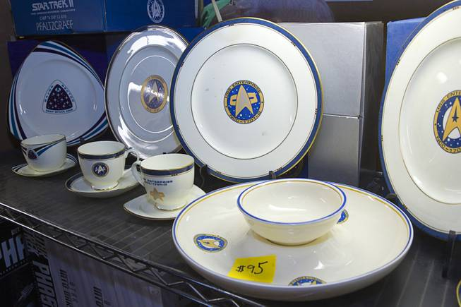 USS Enterprise dinner china is displayed at the Intergalactic Trading Company booth during the 13th annual Official Star Trek Convention at the Rio Thursday, July 31, 2014. The convention, expected to attract 15,000 Trekkies, runs through Sunday.