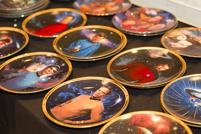 Star Trek collector plates are displayed during the 13th annual Official Star Trek Convention at the Rio Thursday, July 31, 2014. The convention, expected to attract 15,000 Trekkies, runs through Sunday.