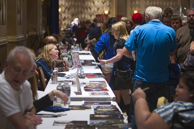 Fans line up to get autographs from Star Trek: The Next Generation actors during the 13th annual Official Star Trek Convention at the Rio Thursday, July 31, 2014. The convention, expected to attract 15,000 Trekkies, runs through Sunday.