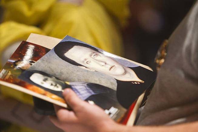 A fan holds a photo of Lt. Commander Data of Star Trek: The Next Generation as he waits in line for autographs during the 13th annual Official Star Trek Convention at the Rio Thursday, July 31, 2014. The convention, expected to attract 15,000 Trekkies, runs through Sunday.