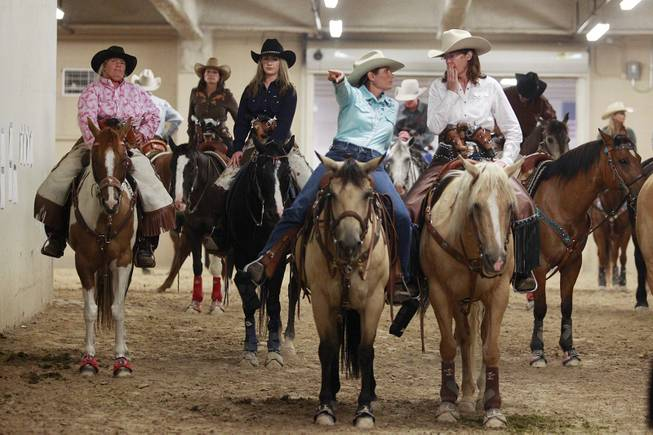 Cowgirls wait to compete during the Cowboy Mounted Shooting Association's Western U.S. ChampionshipThursday, July 31, 2014 at the South Point.