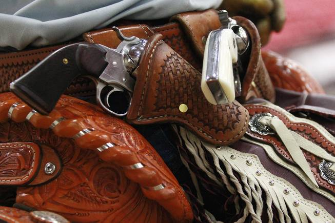 A cowboy's revolvers are seen in their holster during the Cowboy Mounted Shooting Association's Western U.S. ChampionshipThursday, July 31, 2014 at the South Point.