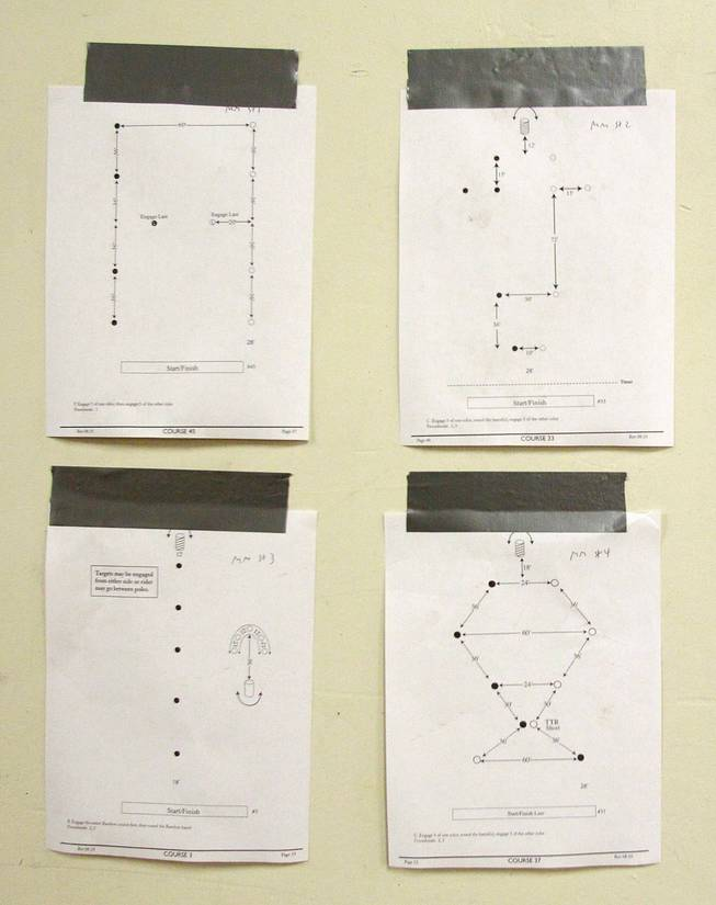 Diagrams of different courses are seen taped to the wall during the Cowboy Mounted Shooting Association's Western U.S. ChampionshipThursday, July 31, 2014 at the South Point.