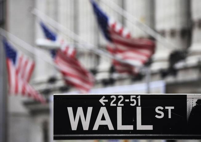 This April 22, 2010, file photo shows a Wall Street sign in front of the New York Stock Exchange.