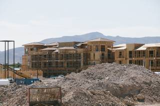 Construction continues on an apartment complex behind Whole Foods at the District at Green Valley Ranch in Henderson on July 31, 2014.