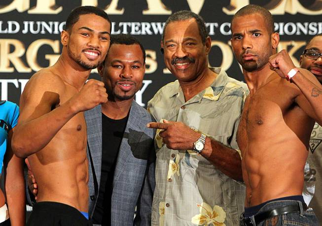 August 1, 2014, Las Vegas,Nevada ---  Shane Mosley Jr. (L) and Jerome Jones (R) weigh in (Mosley Jr  159.6 lbs , Jones 161 lbs) along with  dad/former world champion Shane Mosley (2nd L) and grandfather Jack Mosley(2ndR)  for their upcoming fight on the undercard of Brandon Rios vs Diego Chaves , Saturday, August 2 in the Chelsea at the Cosmopolitan.