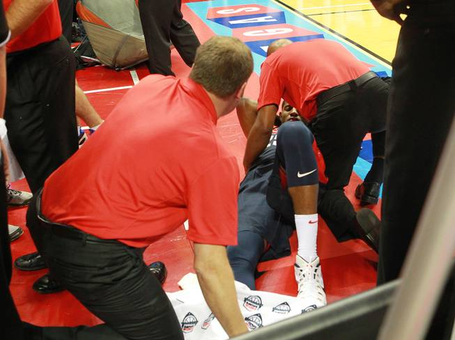Paul George is attended to after fracturing his leg during the 2014 USA Basketball Showcase Friday, Aug. 1, 2014 at the Thomas & Mack Center.