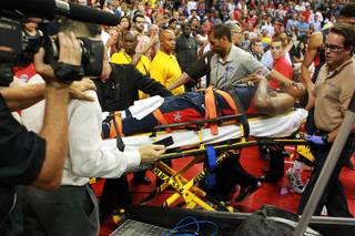 Paul George is wheeled out after fracturing his leg during the 2014 USA Basketball Showcase Friday, Aug. 1, 2014 at the Thomas & Mack Center.
