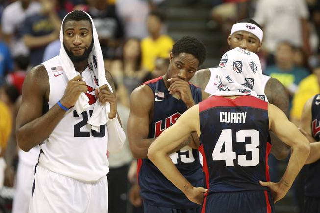 Teammates react after Paul George fractured his leg during the 2014 USA Basketball Showcase Friday, Aug. 1, 2014 at the Thomas & Mack Center.