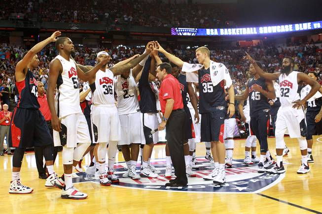 The 2014 USA Basketball team huddle after calling off their game as a result of Paul George fracturing his leg  Friday, Aug. 1, 2014 at the Thomas & Mack Center.