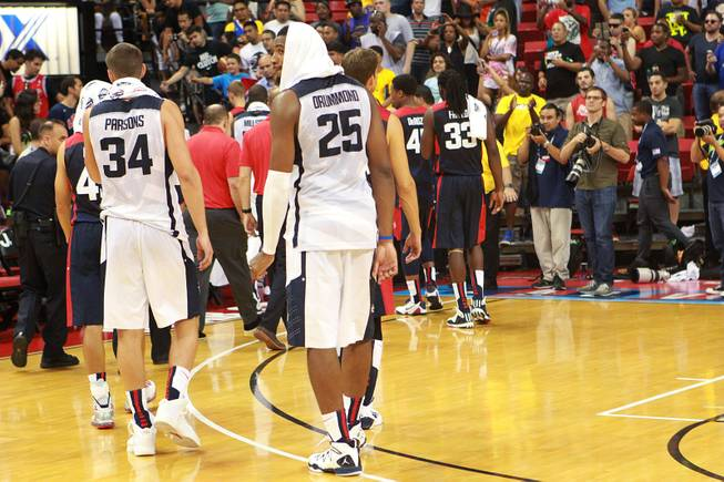 Andre Drummond looks back while heading to the locker room after their  2014 USA Basketball Showcase was called off after Paul George fractured his leg Friday, Aug. 1, 2014 at the Thomas & Mack Center.