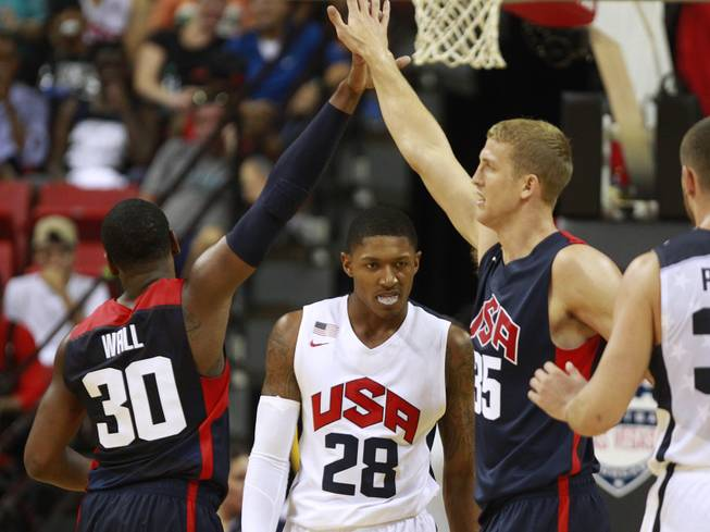 John Wall and Mason Plumlee celebrate after drawing a foul from Bradley Beal, center, during the 2014 USA Basketball Showcase Friday, Aug. 1, 2014 at the Thomas & Mack Center.