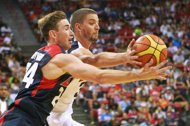 Gordon Hayward, left, and Chandler Parsons chase a rebound during the 2014 USA Basketball Showcase Friday, Aug. 1, 2014 at the Thomas & Mack Center.