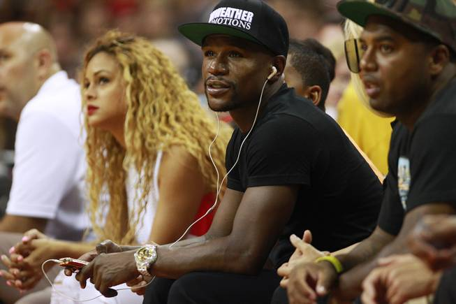 Junior middleweight champion Floyd Mayweather watches the action during the 2014 USA Basketball Showcase Friday, Aug. 1, 2014 at the Thomas & Mack Center.