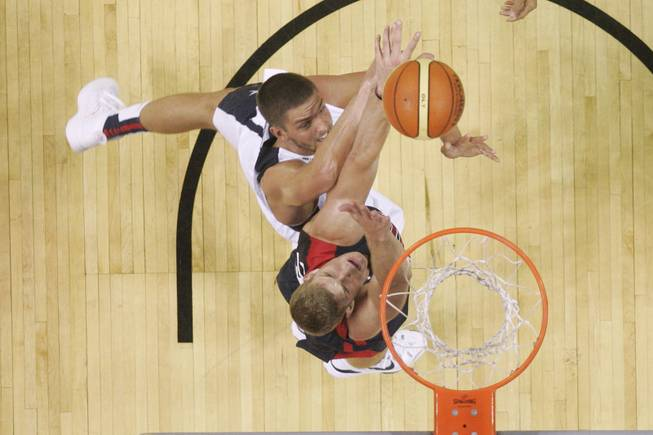 Gordon Hayward, bottom, and Chandler Parsons fight for a rebound during the 2014 USA Basketball Showcase Friday, Aug. 1, 2014 at the Thomas & Mack Center.