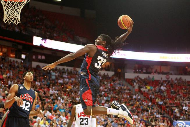 Kenneth Faried sails in for a dunk during the 2014 USA Basketball Showcase Friday, Aug. 1, 2014 at the Thomas & Mack Center.