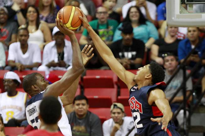 Anthony Davis blocks a shot by Kevin Durant during the 2014 USA Basketball Showcase Friday, Aug. 1, 2014 at the Thomas & Mack Center.