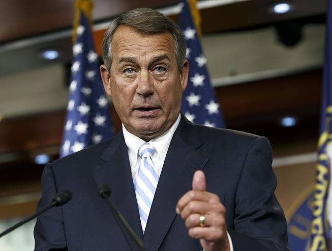 House Speaker John Boehner of Ohio defends the work of the GOP during a brief news conference on Capitol Hill in Washington, Thursday, July 31, 2014, as Congress prepares to leave for a five-week summer recess.