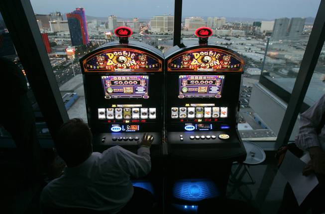 In this June 6, 2007, file photo, Bally Technologies slot machines are showcased at the Palms hotel-casino in Las Vegas.