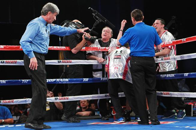 Referee Vic Drakulich warns Diego Chaves's corner between the eighth and ninth round of his welterweight fight against Brandon Rios Saturday, Aug. 2, 2014 at the Cosmopolitan. Rios won after Chaves was disqualified in the ninth round.