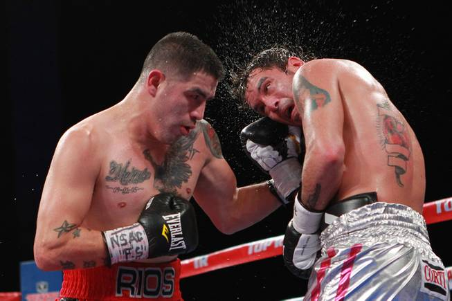 Diego Chaves is hit with a left from Brandon Rios during their welterweight fight Saturday, Aug. 2, 2014 at the Cosmopolitan. Rios won after Chaves was disqualified in the ninth round.