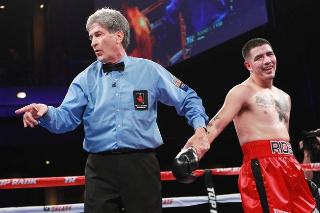 Referee Vic Drakulich deducts a point from Brandon Rios for pushing down Diego Chaves during their welterweight fight Saturday, Aug. 2, 2014 at the Cosmopolitan. Rios won after Chaves was disqualified in the ninth round.
