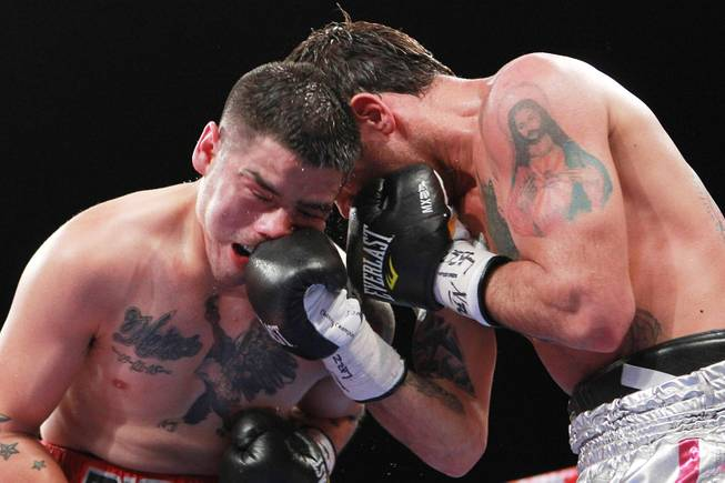 Diego Chaves hits Brandon Rios with a right during their welterweight fight Saturday, Aug. 2, 2014 at the Cosmopolitan. Rios won after Chaves was disqualified in the ninth round.