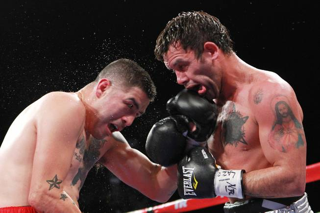 Diego Chaves gets hit with a left from Brandon Rios during their welterweight fight Saturday, Aug. 2, 2014 at the Cosmopolitan. Rios won after Chaves was disqualified in the ninth round.
