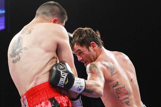 Diego Chaves hits Brandon Rios with a shot to the body during their welterweight fight Saturday, Aug. 2, 2014 at the Cosmopolitan. Rios won after Chaves was disqualified in the ninth round.