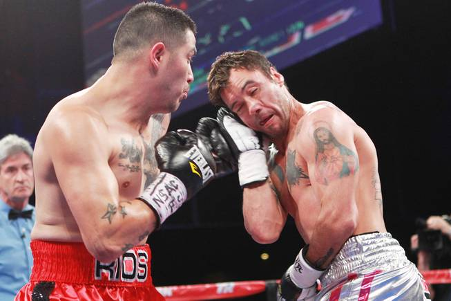 Diego Chaves blocks a left from Brandon Rios during their welterweight fight Saturday, Aug. 2, 2014 at the Cosmopolitan. Rios won after Chaves was disqualified in the ninth round.