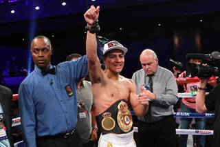 WBA light welterweight champion Jessie Vargas celebrates his unanimous decision over Anton Novikov after their fight Saturday, Aug. 2, 2014 at the Cosmopolitan.