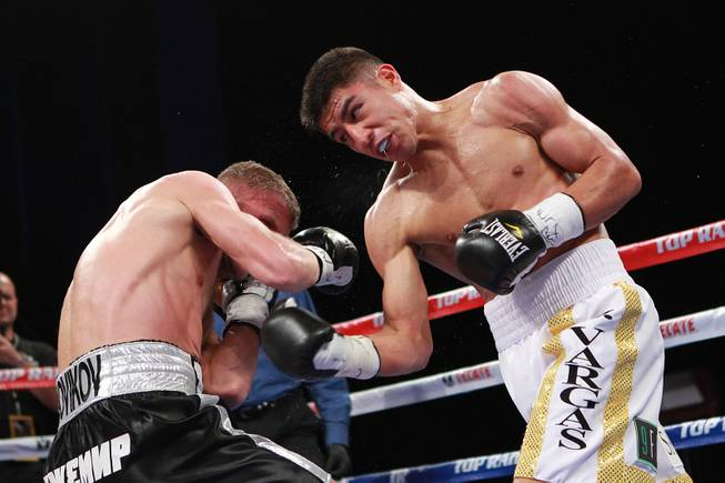 Jessie Vargas hits Anton Novikov with a right during their WBA light welterweight title fight Saturday, Aug. 2, 2014 at the Cosmopolitan. Vargas won by decision.