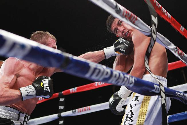 Jessie Vargas is hit by a left from Anton Novikov during their WBA light welterweight title fight Saturday, Aug. 2, 2014 at the Cosmopolitan. Vargas won by decision.