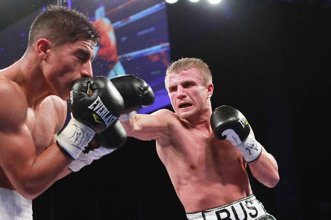 Jessie Vargas is hit by a right from Anton Novikov during their WBA light welterweight title fight Saturday, Aug. 2, 2014 at the Cosmopolitan. Vargas won by decision.