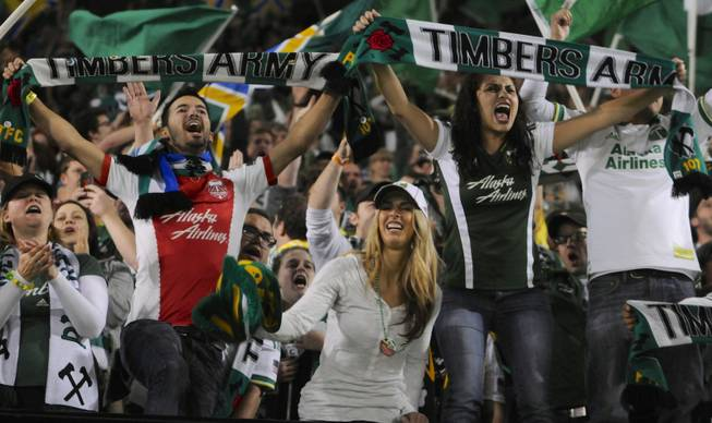 Portland Timbers fans celebrate a 1-0 win against Seattle in an MLS game in Portland, Ore., on Sunday, Oct. 13, 2013.