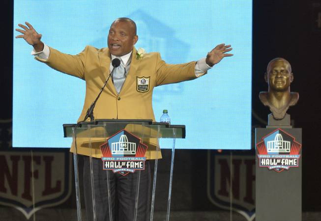 Hall of Fame inductee Aeneas Williams speaks during the Pro Football Hall of Fame enshrinement ceremony Saturday, Aug. 2, 2014 in Canton, Ohio.