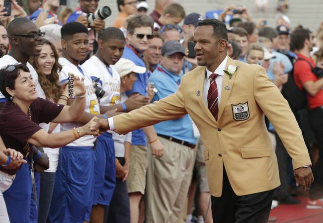Hall of Fame Inductee Andre Reed greets fans as he is introduced during the 2014 Pro Football Hall of Fame Enshrinement Ceremony at the Pro Football Hall of Fame on Saturday, Aug. 2, 2014, in Canton, Ohio.
