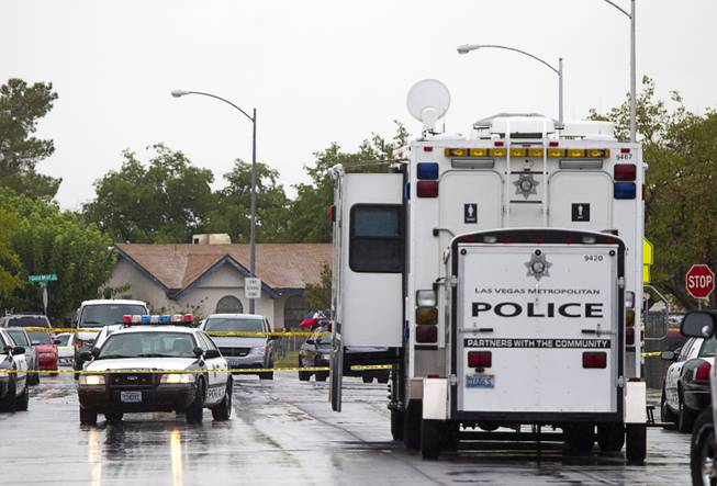 A Metro Police mobile command center is shown at the scene of an officer-involved-shooting near Pecos and Alexander roads August 3 , 2014.