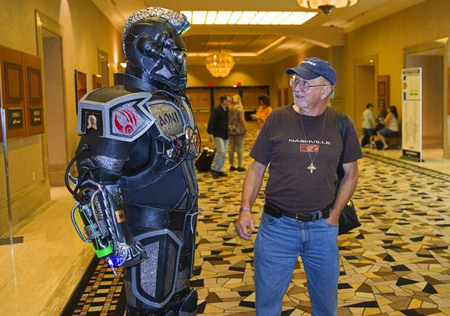 Joe Kopa of Las Vegas looks over an armored Borg concept suit worn by Jerry Powell of Costa Mesa, Calif. during the final day of the 13th annual Official Star Trek Convention at the Rio Sunday, Aug. 3, 2014. The suit is mostly made from cut-up pieces of a Sears workout mat, Powell said.
