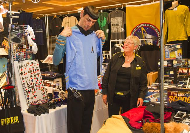 "Paul ""Spock Vegas"" Forest shops for clothes as Angela Ketsten looks on during the final day of the 13th annual Official Star Trek Convention at the Rio Sunday, Aug. 3, 2014."