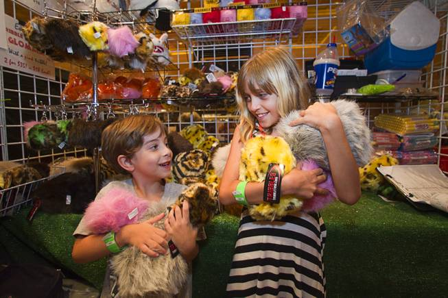 "Nathan Yates, 5, and Linzy McGuire, 9, pose with tribbles at the Tribbble Toy booth during the final day of the 13th annual Official Star Trek Convention at the Rio Sunday, Aug. 3, 2014. Tribbles first appeared in a Star trek episode titled ""The Trouble with Tribbles"" (original series) and are one of the well-known species featured in the Star Trek universe."