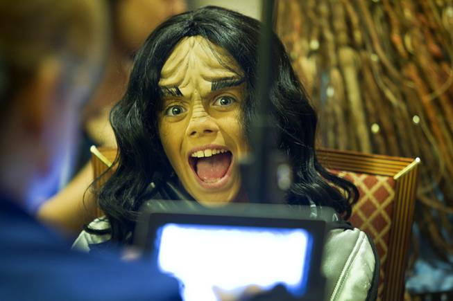 Klingon Naomi Carpenter, 11, of Westminster, M.D., has her portrait done during the final day of the 13th annual Official Star Trek Convention at the Rio Sunday, Aug. 3, 2014.