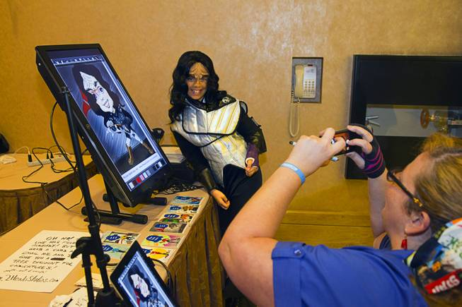 Klingon Naomi Carpenter, 11, of Westminster, M.D., poses for artist Celestia Ward during the final day of the 13th annual Official Star Trek Convention at the Rio Sunday, Aug. 3, 2014.