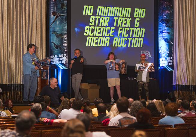 Star Trek collectables are auctioned during the final day of the 13th annual Official Star Trek Convention at the Rio Sunday, Aug. 3, 2014.